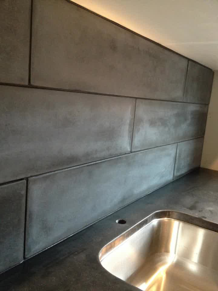 Concrete backsplash looks like subway tiles backsplash black concrete  countertop with stainless steel sink