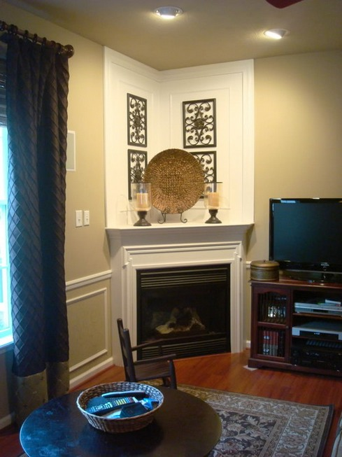 fireplace mantel with a pair of classic candle stands several wall