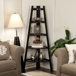 Corner ladder in black finish as a decorative shelves unit sofas with pillows a standing lamp