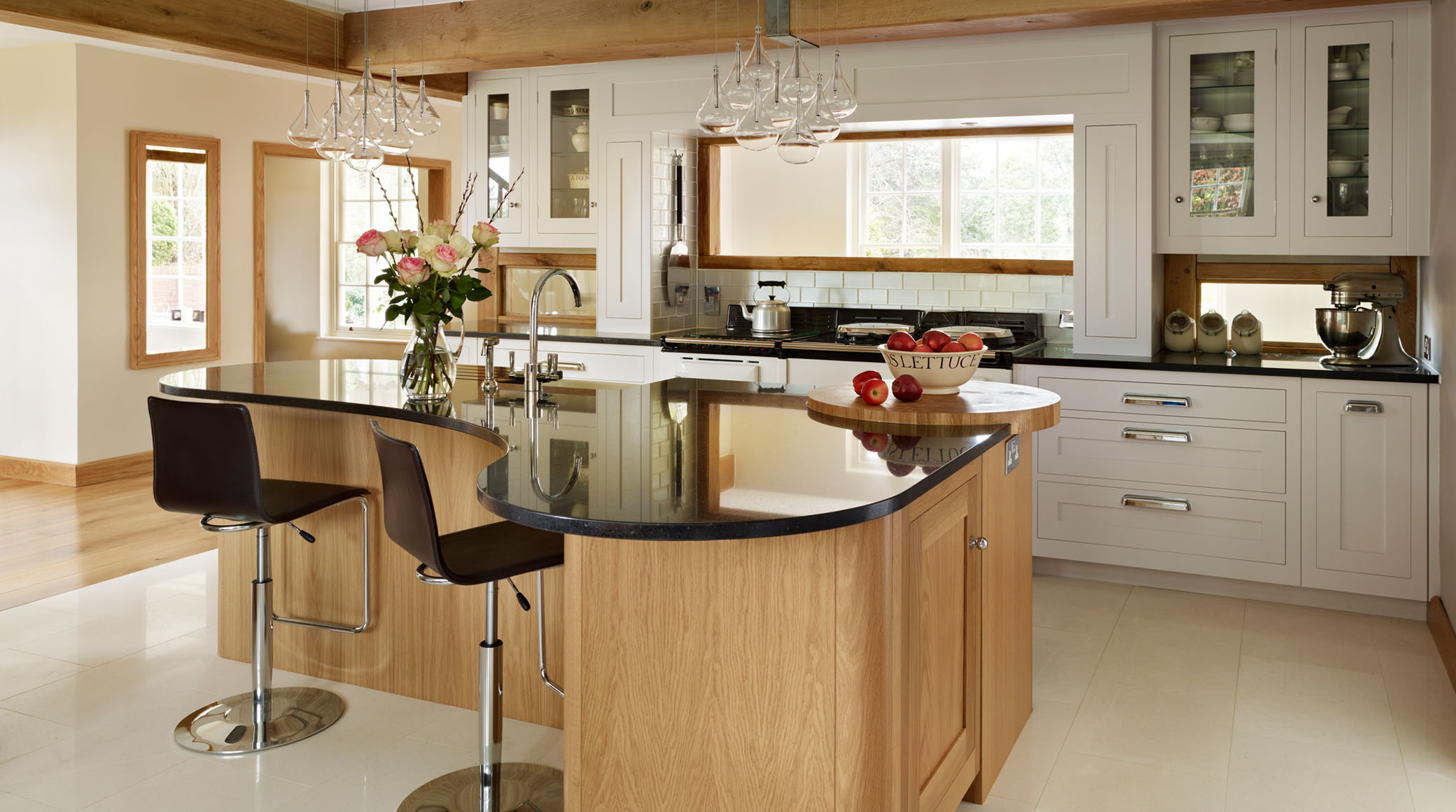 Curved Kitchen Island Made From Wood With Black Glass Surface Sink And  Faucet Two Barstools Two