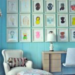 Decorative frames for cute paintings a reading chair an ottoman furniture a working desk made from lightwood material white chair wood planks wall system in blue color