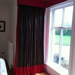 Elegant and modern black and red curtain for corner windows wood planks floor system glass window and trims