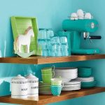 Floating wooden shelves for organizing decorative dishware collections and containers turquoise color paint for wall