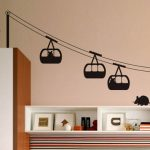 Fun wall art depicting hanging train and cute mice a closet and open shelves