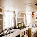 Interior design idea for mobile homes with space effective kitchen set and living room