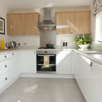 Kitchen  decorating model in white theme with unfinished wooden cabinets on top white kitchen cabinets underneath sink and faucet gas stove unit white ceramic tiles for floors