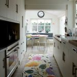 Kitchen rug with beautiful flower motifs small kitcheh set in white theme a small dining furniture