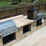 Large natural stones counter in outdoor with large gas stove