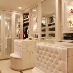 Luxurious ceiling lamp and recessed lamps installed in modern closet organizer room