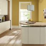 Minimalist curved kitchen island design in white with unfinished wood counter a pair of barstools unfinished planks wood floors unique pendant lamp yellow paint color wall a minimalist kitchen set