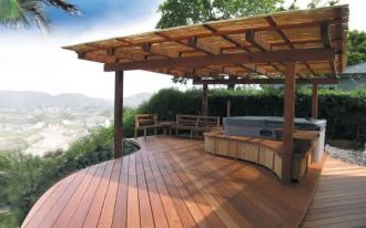 Modern covered deck style made from wooden a pair of long wood chairs and wood planks flooring system