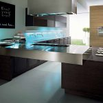 Modern kitchen model in L shape with glossy metal countertop double faucets and double sinks  dark stained wood kitchen island  minimalist kitchen cabinets a black chalkboard wall decoration