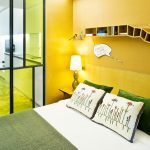 Nice yellow wall painting idea with unique and cool floating shelves painted in yellow color  wood bedside table unique glass wall partition white bedding and cool pillows
