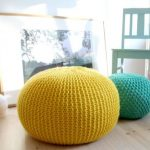 Ottoman pouf in yellow and turquoise wood chair in blue color paint an animal stiff and a large picture frame with wood frame