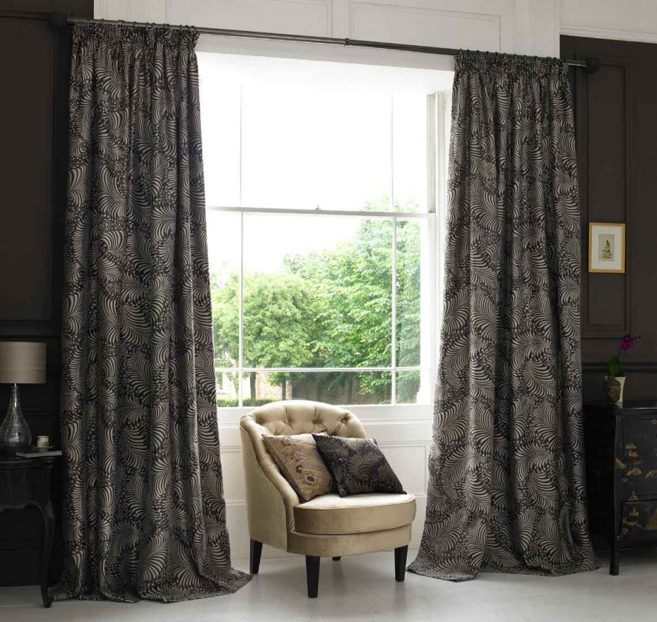 Patterned Dark Curtains In Full Length Size A Corner Chair With Two Decorative Pillows Stained