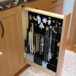 Pull out cabinet with accessories storage