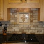 Rustic kitchen backsplash idea with decoration in the center a gas stove wooden cabinets black kitchen cabinets