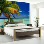 Simple beach bedroom design with simple bed furniture model simple wooden bedside table a tiny legs round table white bedding and pillows beach scenery picture on wall