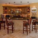 Small Basement Wine Bar With Glossy Black Counter And Darker Staining Wood Barstools  A Group Of Decorative Pendant Lamps Brown Tiles Floor System