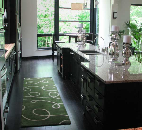 Small Green Kitchen Rug With Simple Pattern Black Wood Planks Floors System  A Luxurious Kitchen Island