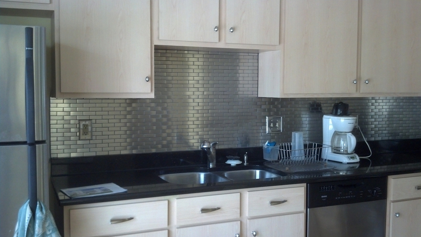 Ikea stainless steel backsplash the point pluses homesfeed for Black and white painted kitchen cabinets