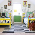 Superhero bedroom designs for two children in Superman theme monochrome rug two bed furniture in yellow color a red basket for storing the animal stuffs a green drawer system with yellow table lamp