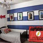 Superhero bedroom idea with several figures of hero pictures on frames  blue and white stripes wall system unique pendant lamp small bed furniture with hero's symbols cover pillows