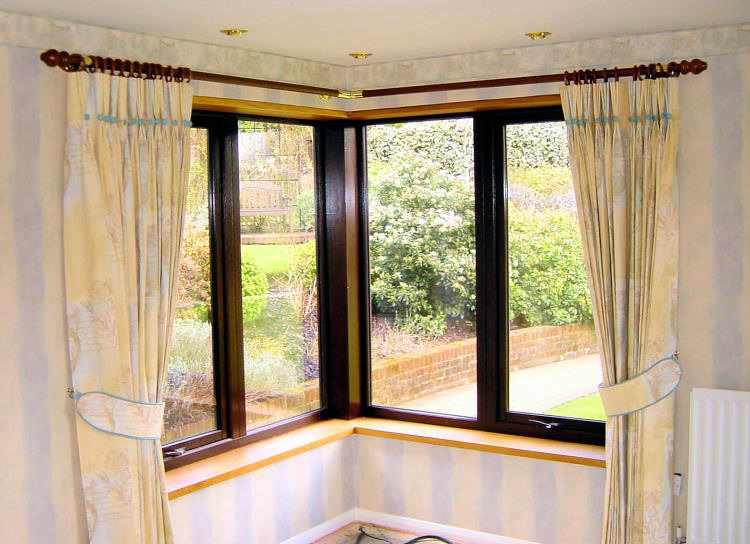 Nice Tied Corner Window Curtains Glass Windows With Black Trims Metal Rods And  Rodu0027s Rings