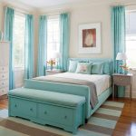 Turquoise bed furniture and headboard white bedding turquoise pillow covers grey and light  turquoise stripes carpet glossy wood floors turquoise window curtains white cabinets grey bedside tables