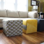 Two ottoman furniture with different motif of fabrics hardwood floors comfy sofa in light grey color scheme