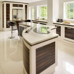 Unique Semi Curved Kitchen Island In White With Wood Accent A Pair Of Barstools White Ceramic Tiles Floors Some Glass Windows With Window Trims A Kitchen Set With Storage