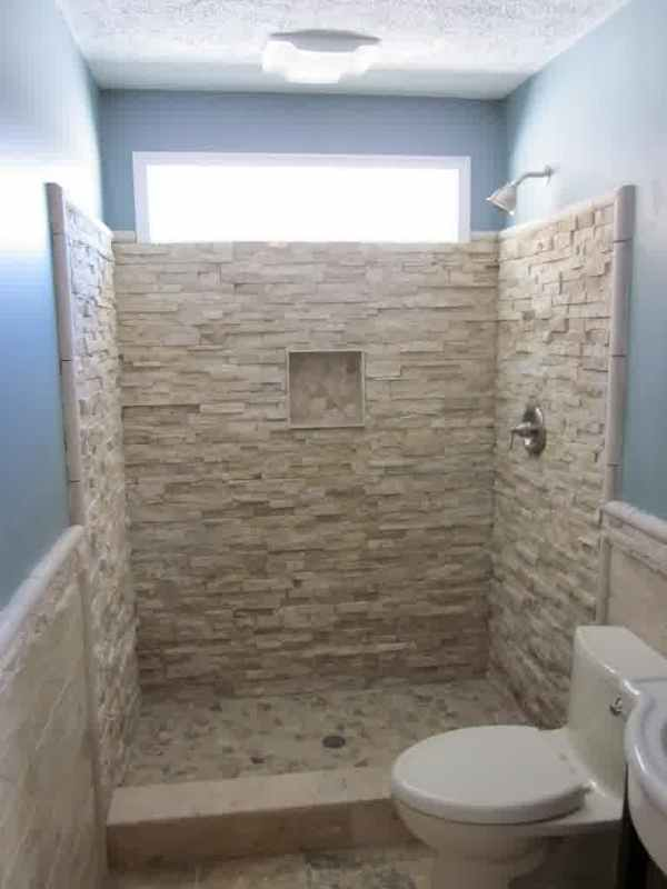 Unique Shower No Door With Textured Wall System And A Toilet Fixture Bathroom Niche