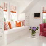 White bench under the bay window with colorful throw pillows a corner storage system in white sweet bold pink sofa with a decorative pillow luxurious transparent glass table