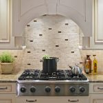 White brick backsplash tiles for kitchen in country style marble kitchen counter modern gas stove unit white cabinetry