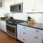 White ceramic subway tiles backsplash for kitchen modern white kitchen cabinet systems a knives organizers gas stove unit