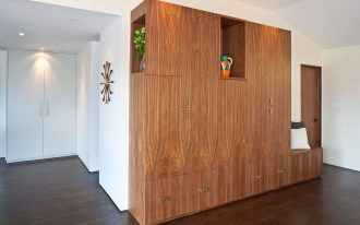 Wooden built in drawers cabinets and shelves with integrated bench