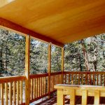 Wooden cover for home deck wood vertical rail system