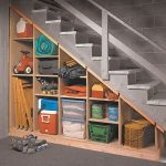 Wooden shelving unit under staircase of basement