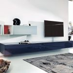 adorable navy blue long media cabinet design beneath white wall storage idea with area rug and television set