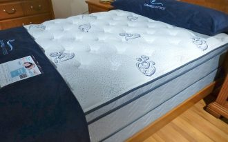 adorable shifman mattress review with blue sheet on tuf pattern with floral accent on wooden floor beneath wooden storage