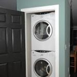 adorable smooth blue laundry room idea aside black wooden storage design with small stackable washer dryer combo in recessed room