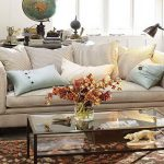 adorable stripe patterned pottery barn couch design with soft blue cushions before glass coffee table and floor lamp with moroccan area rug