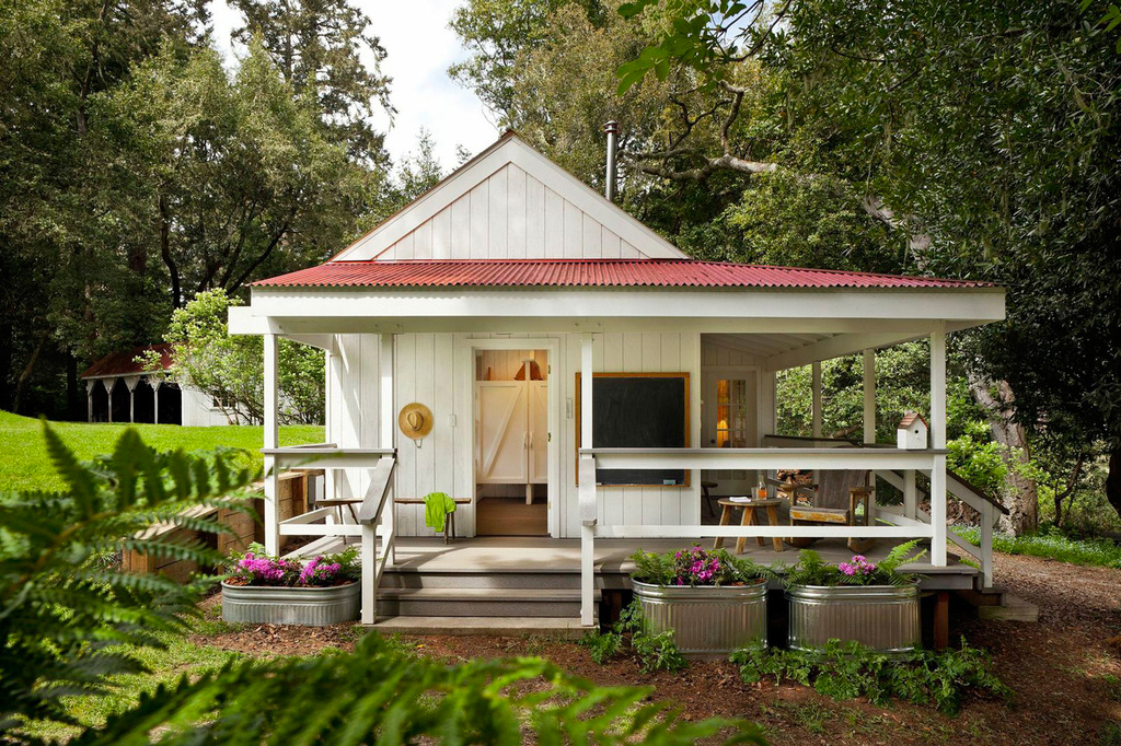 adorable white wooden pier and beam house plan idea with red roof and gry meadow and