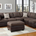 affordable sectional couches in brown with otttoman coffe table on rug with wooden floor and round glass top end table plus pictures on wall decoration