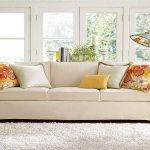 amazing living room ideas with pottery barn sofa reviews feat decorative cushions and white rug plus stunning standing lamp and glass door