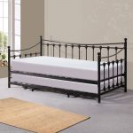 astonishing black metal day bed with pop up trundle design with white elegant bolster and cream rug in gray room