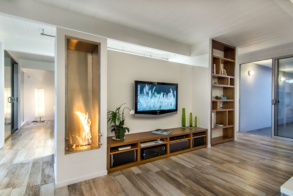 Astonishing Long Media With Storage Design Between Tall Recessed Bookshelves  With Fireplace On Wooden Floor In