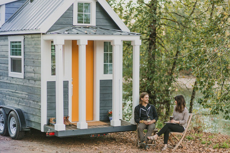 astonishing small mobile home that looks like house with gray wall and  orange door with transparent