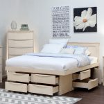 awesome compact white wooden storage bed nyc design with white bed sheet and pillows and wall gallery and corner armoire and chevron patterned area rug