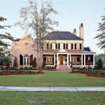 awesome creamy southern living house plans with picture design with large grassy meadow and landscape and walkway and towers with lush vegetation